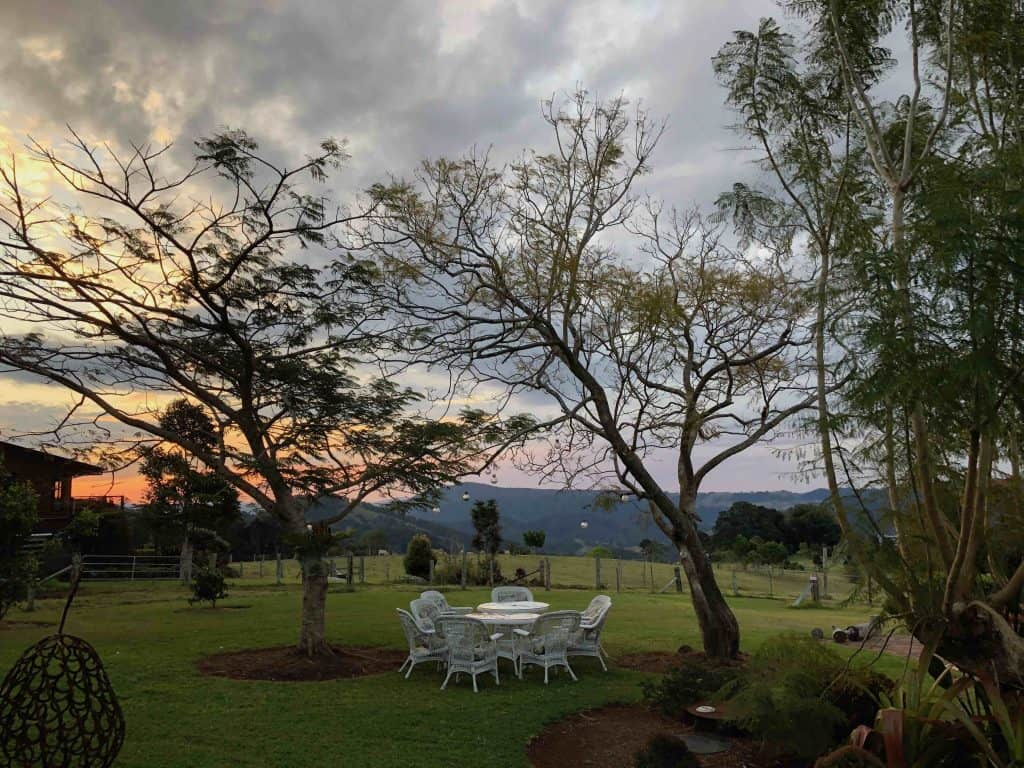 Elope to an exclusive location on the Sunshine Coast hinterland near Maleny for a private elopement under the jacaranda trees